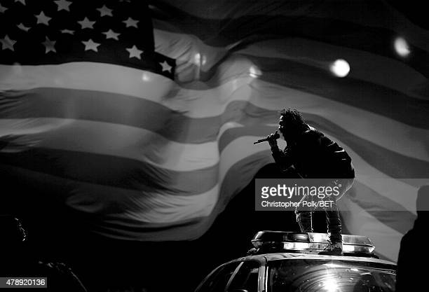 Image was shot in black and white Color version not available Recording artist Kendrick Lamar performs onstage during the 2015 BET Awards at the...