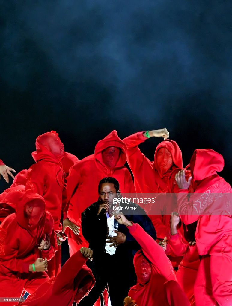Recording artist Kendrick Lamar (C) performs onstage during the 60th Annual GRAMMY Awards at Madison Square Garden on January 28, 2018 in New York City.