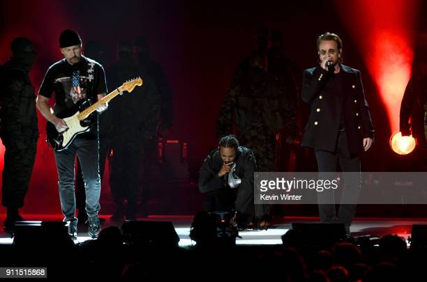 Recording artist Kendrick Lamar performs with The Edge and Bono of music group U2 onstage during the 60th Annual GRAMMY Awards at Madison Square...