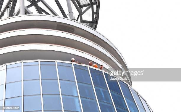 Recording Artist Kenny Chesney and SiriusXM Host Storme Warren throw pumpkins off the balcony at SiriusXM Studios on October 23 2017 in Nashville...