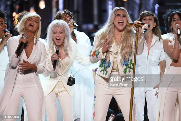 Recording artist Kesha performs with Bebe Rexha Cyndi Lauper and Camila Cabello onstage during the 60th Annual GRAMMY Awards at Madison Square Garden...