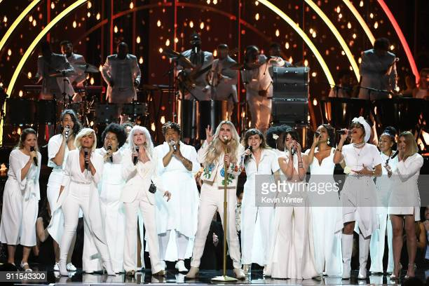 Recording artist Kesha performs with Bebe Rexha Cyndi Lauper Camila Cabello Andra Day and chorus members onstage during the 60th Annual GRAMMY Awards...