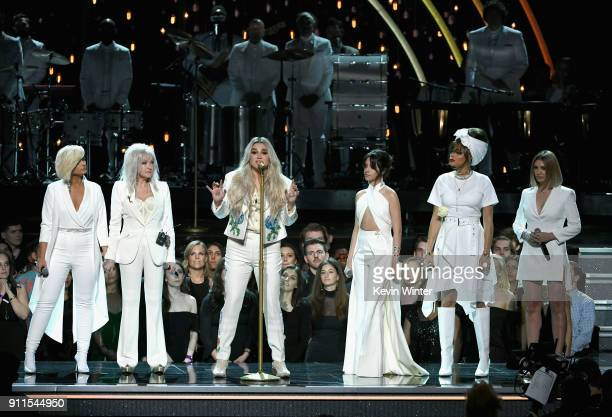 Recording artist Kesha performs with Bebe Rexha Cyndi Lauper Camila Cabello Andra Day Julia Michaels and chorus members onstage during the 60th...