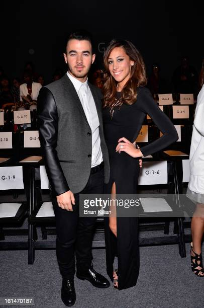 Recording artist Kevin Jonas and Danielle Jonas attend Pamella Roland during Fall 2013 MercedesBenz Fashion Week at The Studio at Lincoln Center on...