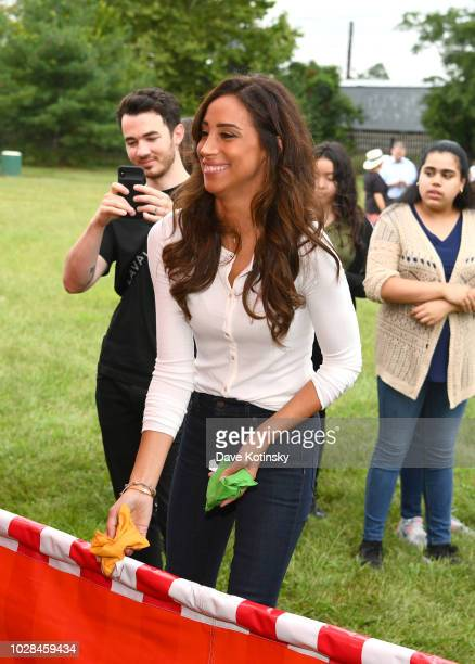 Recording artist Kevin Jonas and Social Influencer Danielle Jonas enjoy activities as she attends as Vera Bradley partners with Blessings In A...