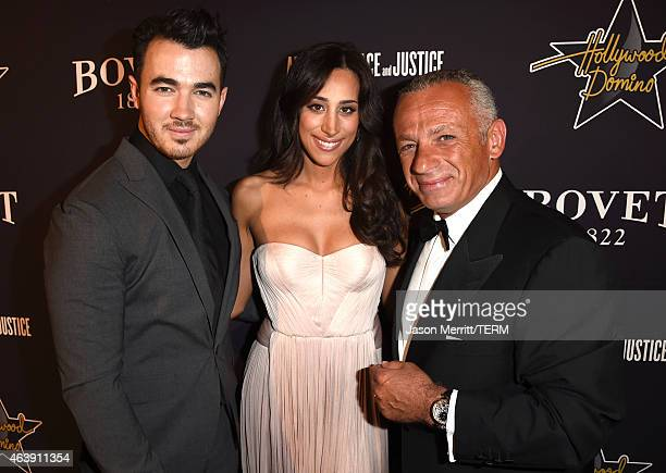 Recording artist Kevin Jonas Danielle Jonas and CEO of Bovet Pascal Raffy attend the 8th annual Hollywood Domino Gala presented by BOVET 1822...