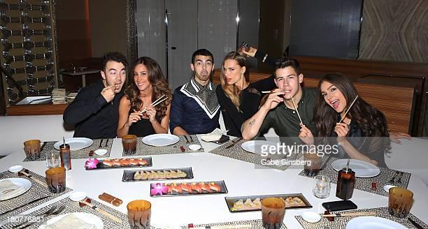 Recording artist Kevin Jonas Danielle Jonas recording artist Joe Jonas Blanda Eggenschwiler recording artist Nick Jonas and Olivia Culpo celebrate...