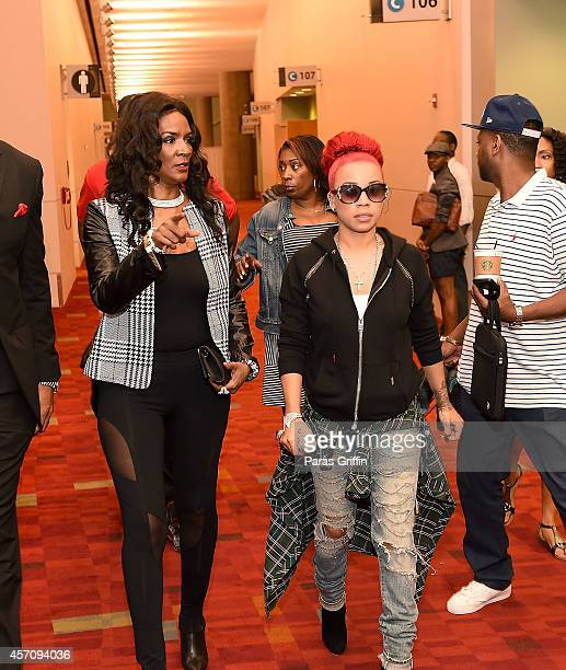 Recording artist Keyshia Cole and television personality Momma Dee arrive at the 2014 V103 For Sisters Only at Georgia World Congress Center on...