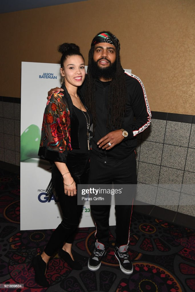 Recording artist Kia Shine (R) and guest attend 'Game Night' Atlanta screening at Regal Atlantic Station on February 20, 2018 in Atlanta, Georgia.