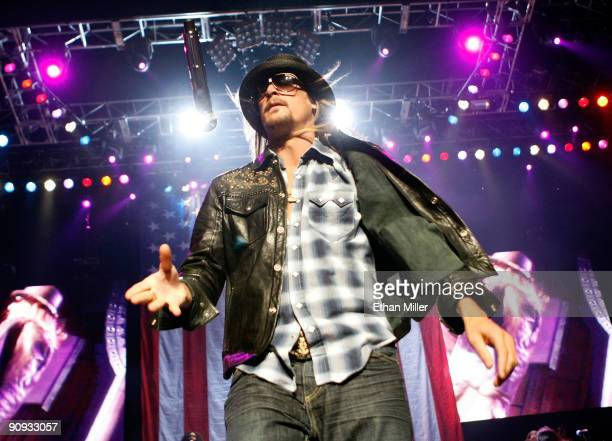 Recording artist Kid Rock flips his microphone as he performs at The Pearl concert theater at the Palms Casino Resort September 17 2009 in Las Vegas...