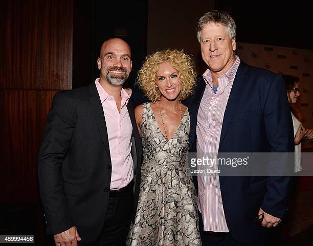 Recording Artist Kimberly Schlapman of Little Big Town along with her husband Stephen and CAA's John Huie attend the 2015 Women in Music City Awards...