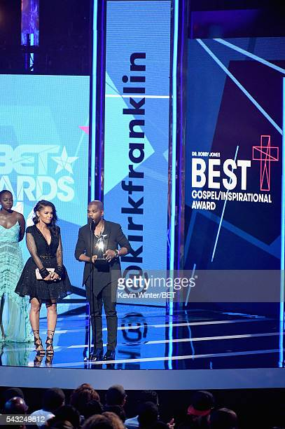 Recording artist Kirk Franklin accepts the Best Gospel/Inspirational award onstage as Tammy Collins looks on during the 2016 BET Awards at the...