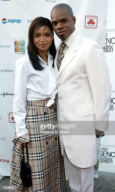 Recording artist Kirk Franklin and his wife Tammy attend the 15th Annual Essence Awards May 31 2002 in Los Angeles CA