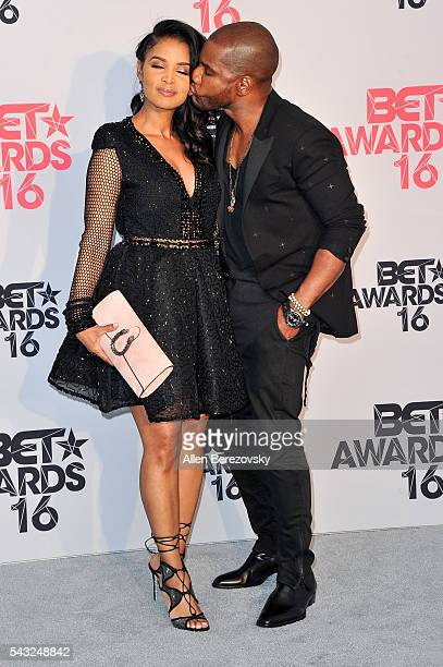 Recording artist Kirk Franklin and wife Tammy Collins pose for pictures in the press room during the 2016 BET Awards at Microsoft Theater on June 26...
