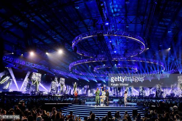 Recording artist Lady Gaga actors Winston Duke Chadwick Boseman and Michael B Jordan accepting accept the Best Movie award for 'Black Panther' and...