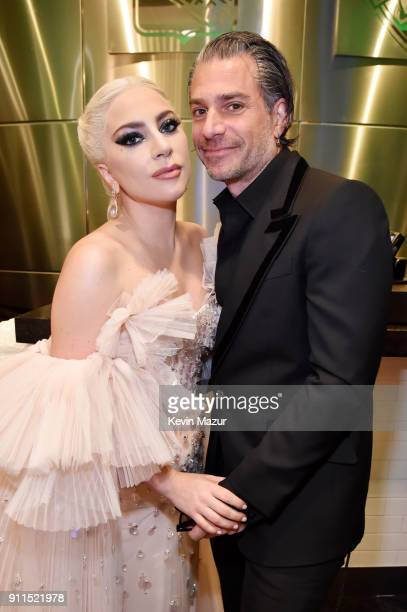 Recording artist Lady Gaga and agent Christian Carino embrace backstage at the 60th Annual GRAMMY Awards at Madison Square Garden on January 28 2018...