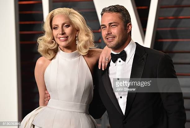 Recording artist Lady Gaga and Taylor Kinney arrive at the 2016 Vanity Fair Oscar Party Hosted By Graydon Carter at Wallis Annenberg Center for the...