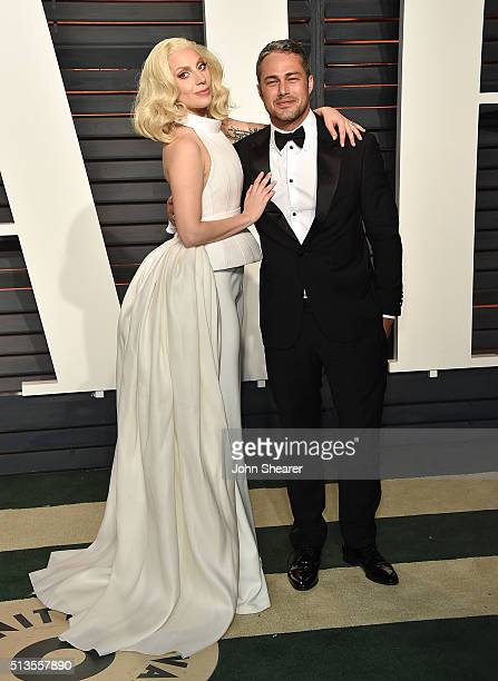 Recording artist Lady Gaga, left, and Taylor Kinney arrive at the 2016 Vanity Fair Oscar Party Hosted By Graydon Carter at Wallis Annenberg Center...