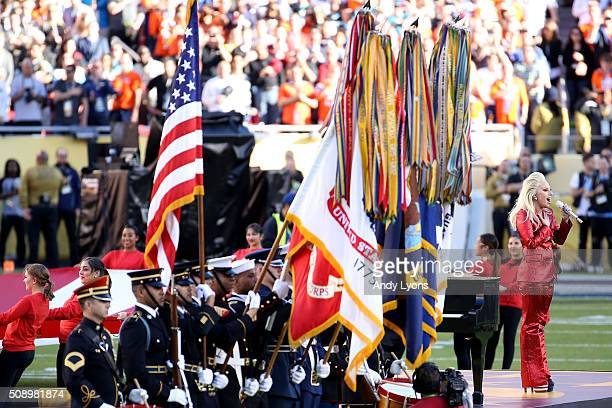 Recording artist Lady Gaga performs the national anthem prior to Super Bowl 50 between the Denver Broncos and the Carolina Panthers at Levi's Stadium...