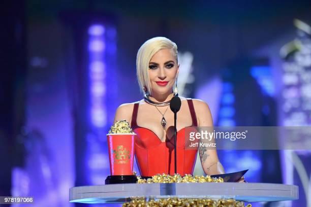 Recording artist Lady Gaga speaks onstage at the 2018 MTV Movie And TV Awards at Barker Hangar on June 16 2018 in Santa Monica California