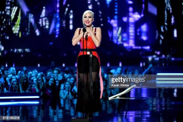 Recording artist Lady Gaga speaks onstage during the 2018 MTV Movie And TV Awards at Barker Hangar on June 16, 2018 in Santa Monica, California.