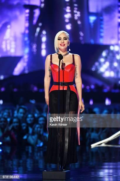 Recording artist Lady Gaga speaks onstage during the 2018 MTV Movie And TV Awards at Barker Hangar on June 16 2018 in Santa Monica California