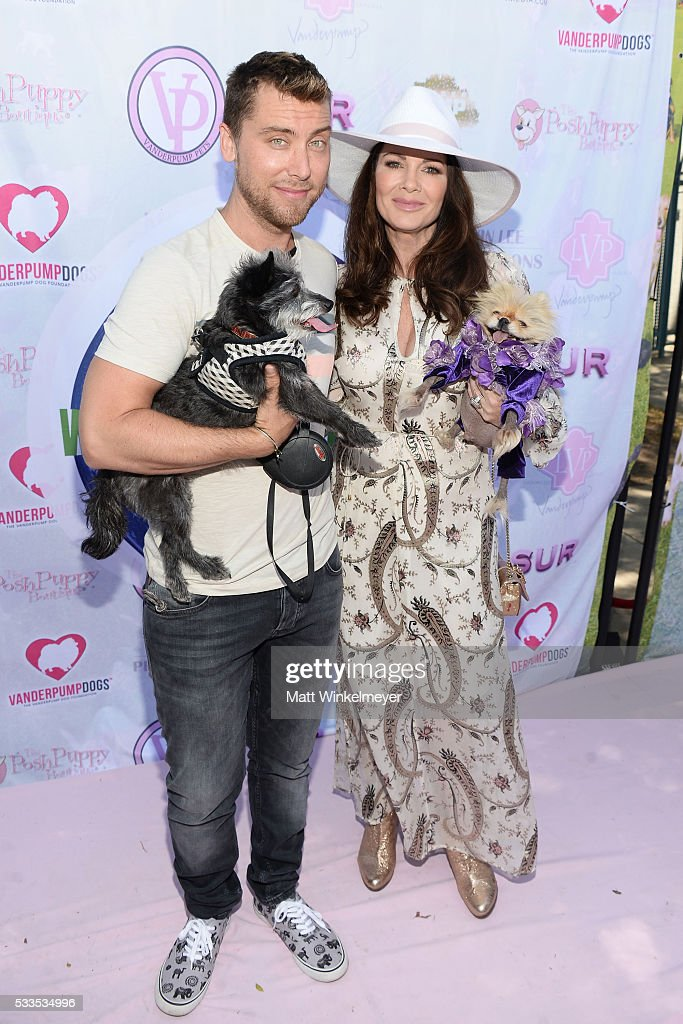 Recording artist Lance Bass (L) and TV personality Lisa Vanderpump attend the World Dog Day Celebration at The City of West Hollywood Park on May 22, 2016 in West Hollywood, California.