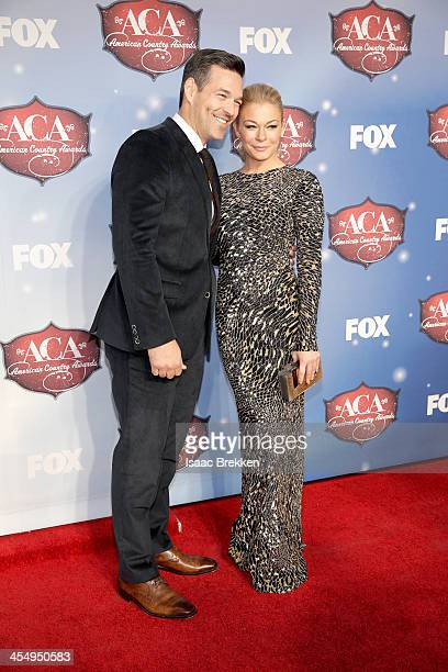 Recording artist LeAnn Rimes and actor Eddie Cibrian arrive at the American Country Awards 2013 at the Mandalay Bay Events Center on December 10,...