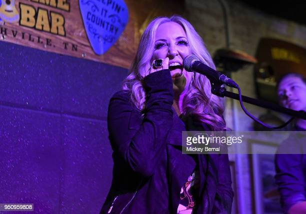 Recording Artist Lee Ann Womack performs during MusiCares Country Music Night at Aj's Good Time Bar on April 24 2018 in Nashville Tennessee