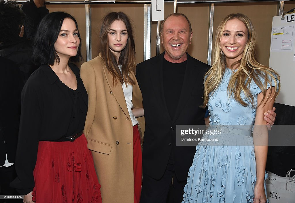 Recording Artist Leigh Lezark, model Laura Love, designer Michael Kors and DJ Harley Viera-Newton pose backstage at the Michael Kors Fall 2016 Runway Show during New York Fashion Week: The Shows at Spring Studios on February 17, 2016 in New York City.