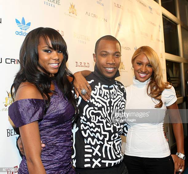 Recording artist LeToya Luckett AJ Crimson and recording artist Olivia pose for a picture during his birthday celebration at ADIDAS Originals on...