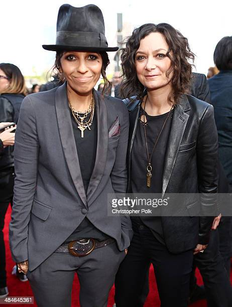 Recording artist Linda Perry and actress Sara Gilbert attend the 2014 MTV Movie Awards at Nokia Theatre LA Live on April 13 2014 in Los Angeles...