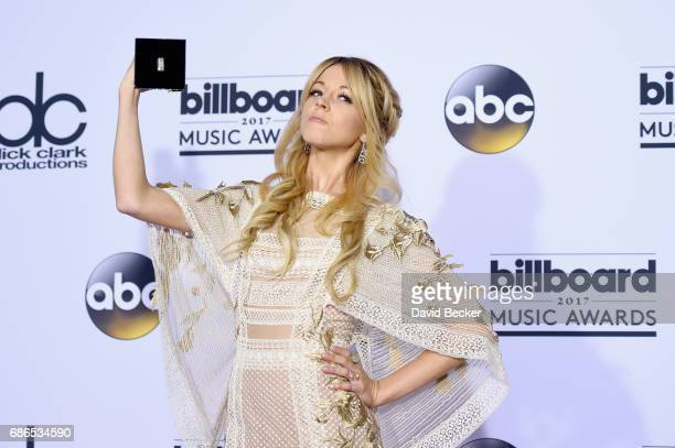 Recording artist Lindsey Stirling winner of the Top Dance/Electronic Album award for 'Brave Enough' poses in the press room during the 2017 Billboard...