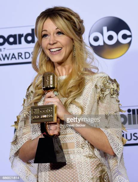 Recording artist Lindsey Stirling winner of Top Dance/Electronic Album award for 'Brave Enough' poses in the press room during the 2017 Billboard...