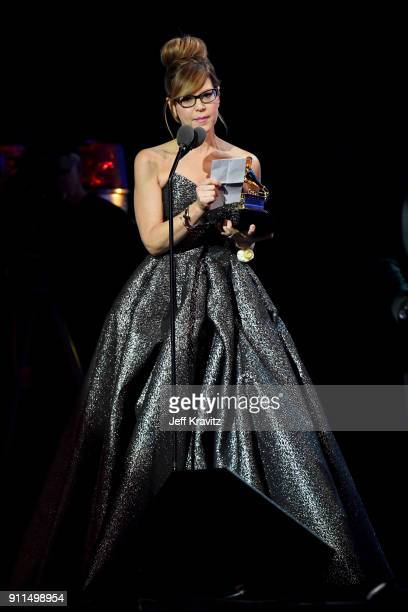 Recording artist Lisa Loeb accepts the award onstage for 'Best Children's Album' onstage at the premiere ceremony during the 60th Annual GRAMMY...