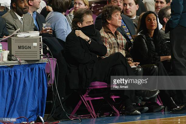 Recording artist Lou Reed sits next to Comedian Richard Lewis who covers his nose from the smell after Rodney White of the Nuggets got sick during...
