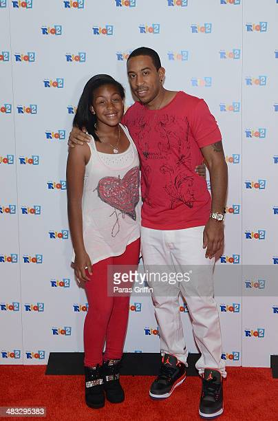 "Recording Artist Ludacris and his daughter Karma Bridges attends ""Rio 2"" screening at Regal Atlantic Station on April 7, 2014 in Atlanta, Georgia."