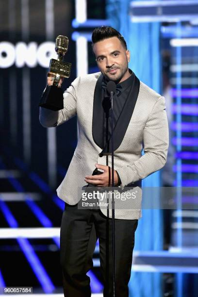Recording artist Luis Fonsi accepts an award onstage during the 2018 Billboard Music Awards at MGM Grand Garden Arena on May 20 2018 in Las Vegas...