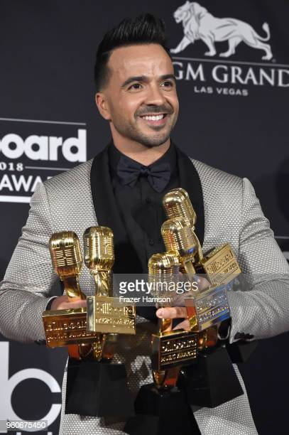 Recording artist Luis Fonsi poses in the press room during the 2018 Billboard Music Awards at MGM Grand Garden Arena on May 20 2018 in Las Vegas...
