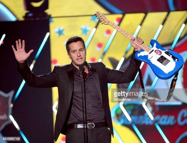 Recording artist Luke Bryan accepts the award for Artist of the Year onstage during the American Country Awards 2013 at the Mandalay Bay Events...