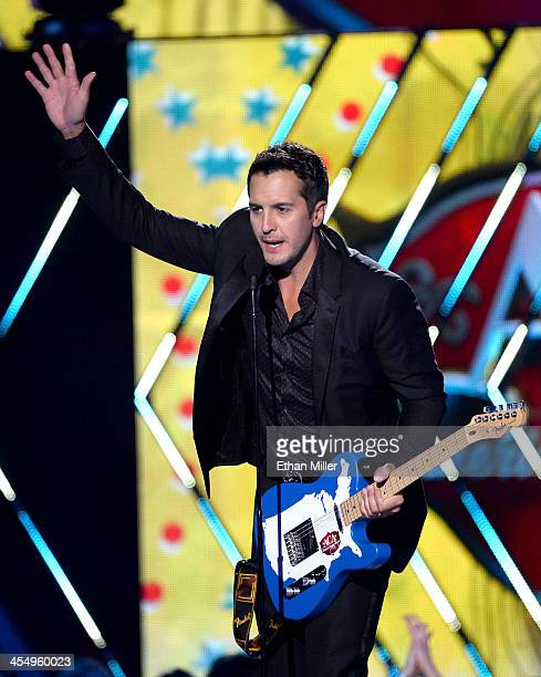 Recording artist Luke Bryan accepts the Male Artist of the Year award onstage during the American Country Awards 2013 at the Mandalay Bay Events...
