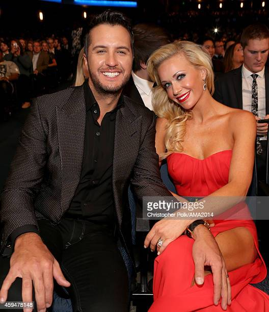 Recording artist Luke Bryan and Caroline Boyer attend the 2014 American Music Awards at Nokia Theatre LA Live on November 23 2014 in Los Angeles...
