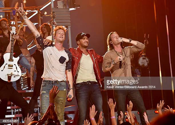 Recording artist Luke Bryan and Florida Georgia Line members Brian Kelley and Tyler Hubbard perform onstage during the 2014 Billboard Music Awards at...