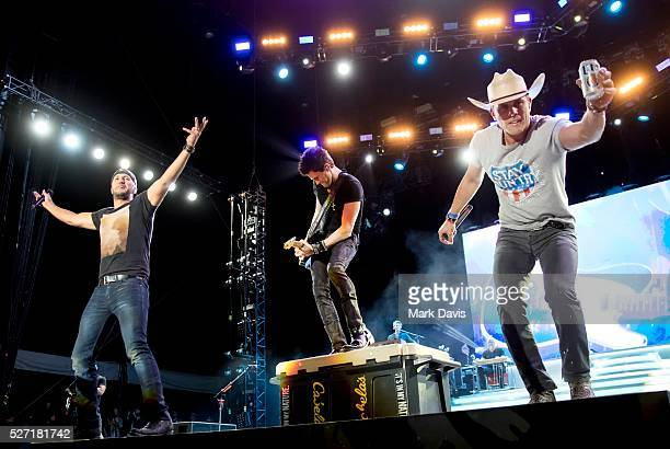Recording artist Luke Bryan guitarist Michael Carter and singer Dustin Lynch perform onstage during the 2016 Stagecoach California's Country Music...