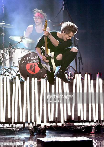Recording artist Luke Hemmings of 5 Seconds of Summer performs onstage at the 2014 American Music Awards at Nokia Theatre LA Live on November 23 2014...
