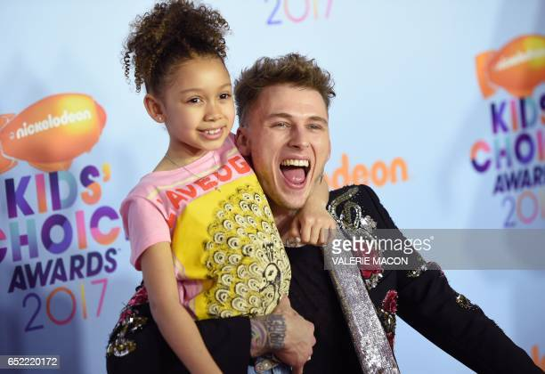 Recording artist Machine Gun Kelly and Casie Colson Baker arrive for the 30th Annual Nickelodeon Kids' Choice Awards March 11 2017 at the Galen...