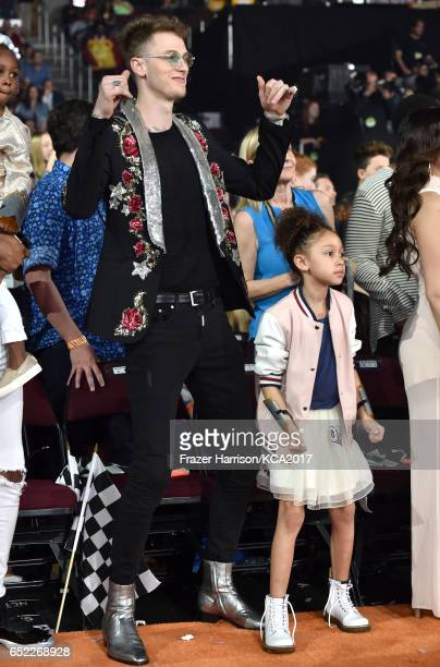 Recording artist Machine Gun Kelly and Casie Colson Baker dance in the audience at Nickelodeon's 2017 Kids' Choice Awards at USC Galen Center on...