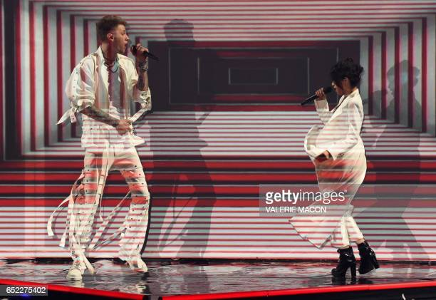 Recording artist Machine Gun Kelly and Casie Colson Baker perform during the 30th Annual Nickelodeon Kids' Choice Awards March 11 at the Galen Center...