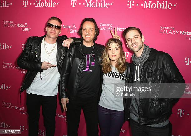 Recording artist Macklemore, CEO of T-Mobile John Legere, Christina Legere and recording artist Ryan Lewis attend Macklemore & Ryan Lewis presented...
