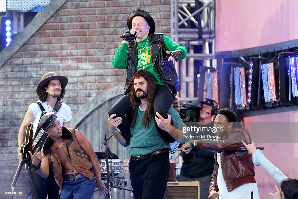 Recording artist Macklemore (center) performs on the Pepsi Stage, during the 2015 MTV Video Music Awards, at The Orpheum Theatre on August 30, 2015 in Los Angeles, California.